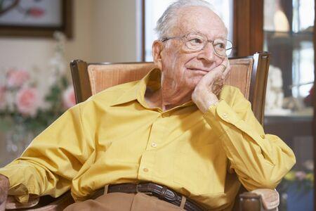 nineties: Senior man relaxing in armchair Stock Photo