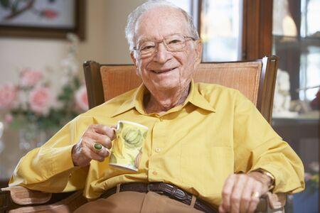 Senior man drinking hot beverage Stock Photo - 4607313