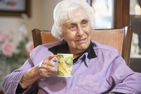 Senior woman drinking hot beverage Stock Photo - 4607711