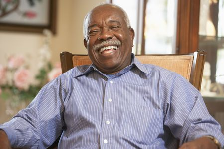 one senior: Senior man relaxing in armchair Stock Photo