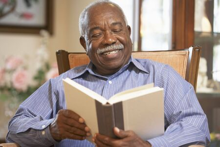 Senior man reading book Stock Photo - 4607700