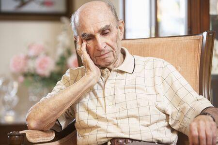 nineties: Senior man resting in armchair