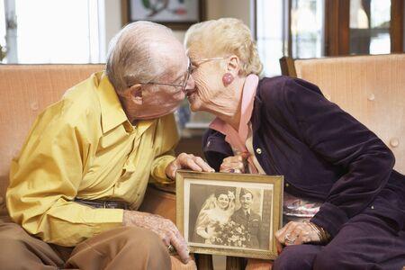 nineties: Senior couple holding wedding photo Stock Photo