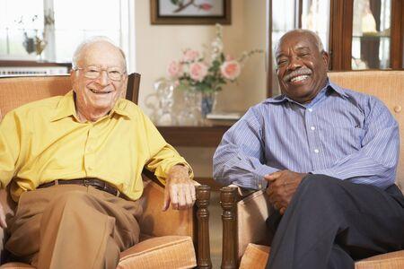 Senior men relaxing in armchairs Stock Photo