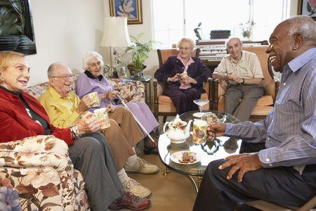 nursing home: Senior adults having morning tea together