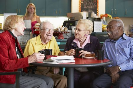 Senior adults having morning tea together photo