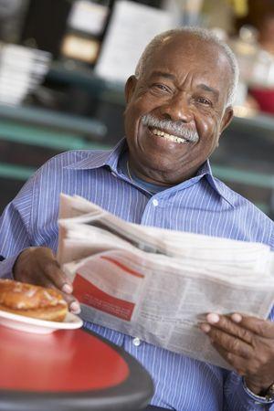 Senior man having morning tea photo