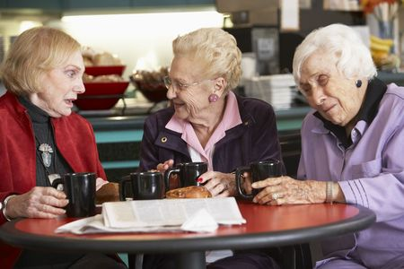 senior women: Senior women drinking tea together