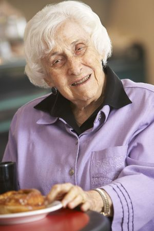 morning tea: Senior woman having morning tea Stock Photo