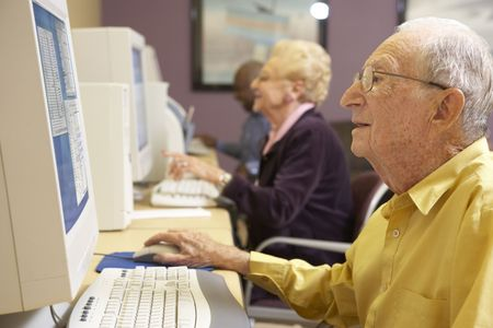 Senior man using computer photo