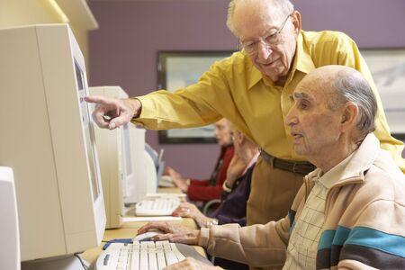 Senior men using computer photo