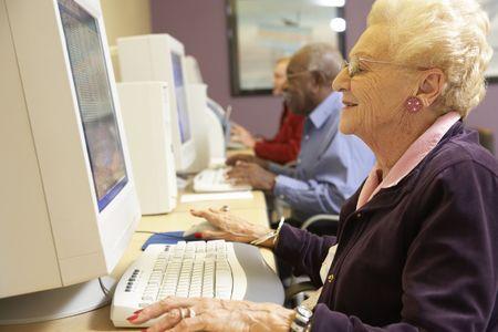 using computer: Senior woman using computer Stock Photo