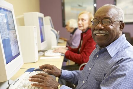 male senior adult: Senior man using computer