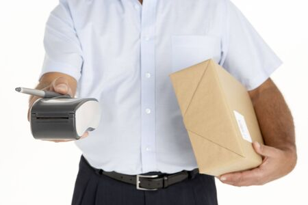 Courier Holding A Parcel And An Electronic Clipboard photo