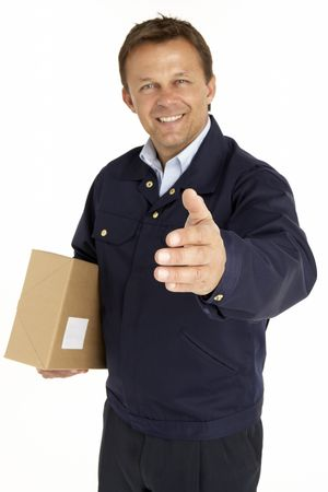 extending: Courier Extending His Hand For A Handshake And Holding A Parcel Stock Photo