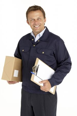 Portrait Of Courier Holding A Parcel And Clipboard photo