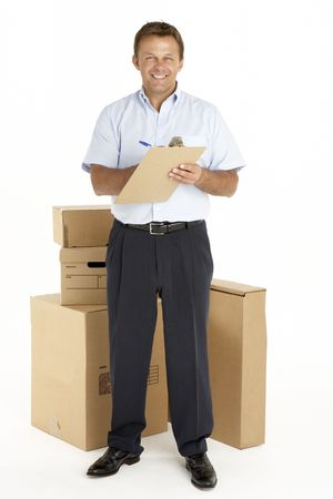 Portrait Of Courier Standing Next To Parcels, Holding A Clipboard photo