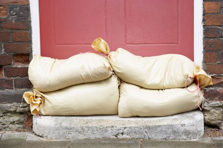 Sandbags Stacked In A Doorway In Preparation For Flooding photo