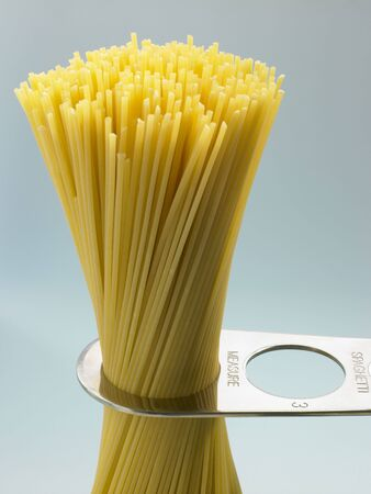 measured: Spaghetti Pasta Being Measured Stock Photo