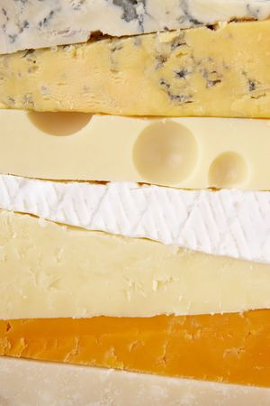 cheeses: Stack Of Different Cheeses