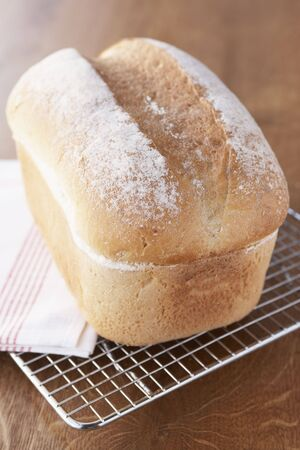 Fresh Bread Loaf Cooling On Wire Rack photo