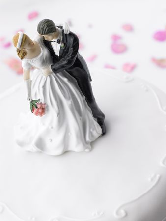Wedding Cake With Bride And Groom Figurines photo