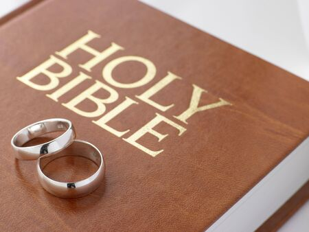 Wedding Rings Resting On A Holy Bible photo