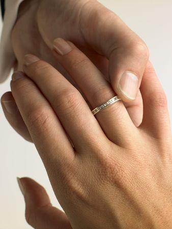 Man Putting Diamond Ring On Womans Finger photo