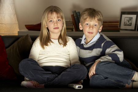 Brother And Sister Watching Television Stock Photo - 4644753
