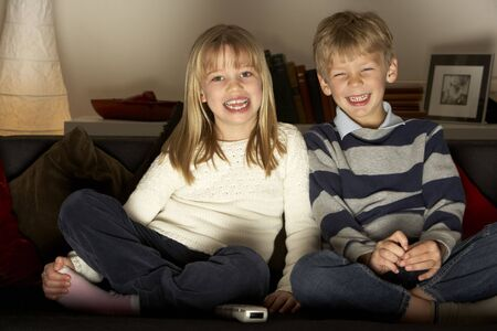 Brother And Sister Watching Television Stock Photo - 4644811