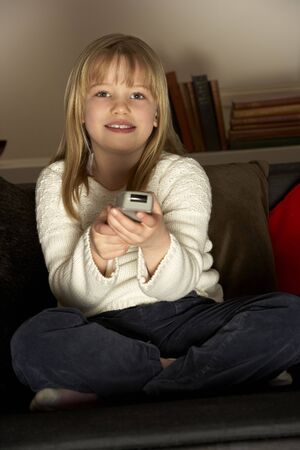 elementary age girls: Young Girl Using Remote Control