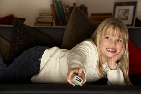 Young Girl Using Television Remote Control Stock Photo - 4644765