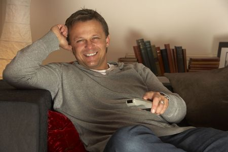 Man Relaxing With Remote Control photo