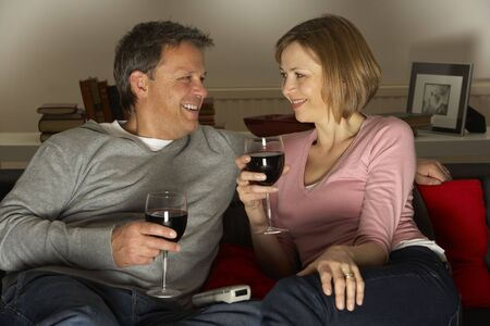 Couple Drinking Wine And Not Watching Television photo