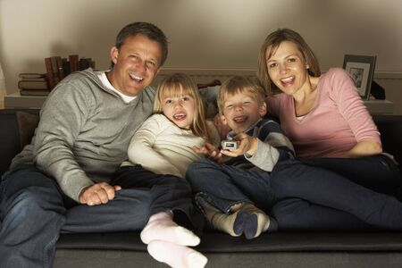 Family Watching Television Together Stock Photo - 4644795
