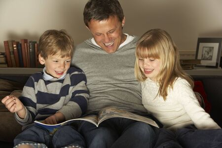 Father And Two Children Reading Stock Photo - 4644771