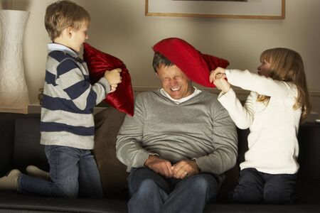 Father And Two Children In Pillow Fight photo