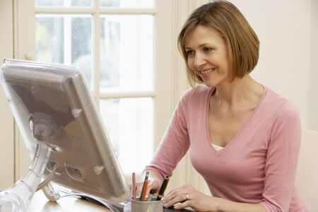 40s: Woman Using Computer Stock Photo