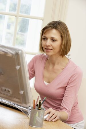 working from home: Woman Using Computer Stock Photo