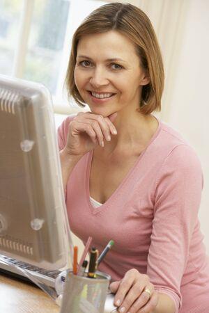 using computer: Woman Using Computer Stock Photo