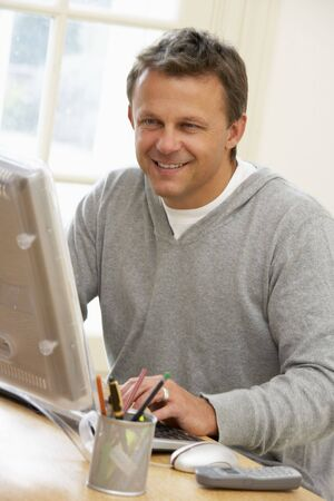 using computer: Man Using Computer