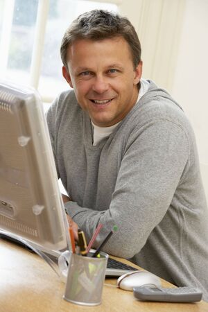40s adult: Man Using Computer