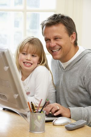using computer: Father And Daughter Using Computer