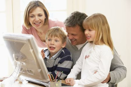 using computer: Family Group Using Computer Stock Photo
