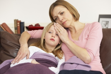 Mother Taking Temperature Of Sick Daughter Stock Photo - 4644747