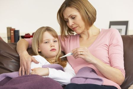 Mother Taking Temperature Of Sick Daughter Stock Photo - 4644818