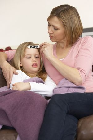 Mother Taking Temperature Of Sick Daughter Stock Photo - 4644751