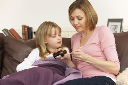 Mother Giving Medicine To Sick Daughter Stock Photo - 4644745