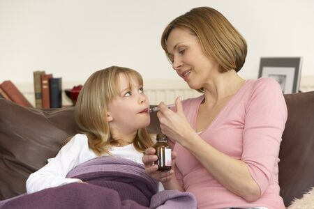Mother Giving Medicine To Sick Daughter Stock Photo - 4644750