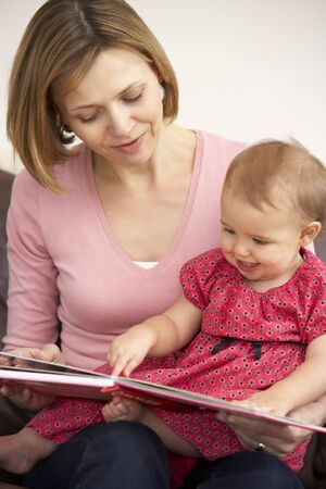 Mother And Baby Daughter Reading Book photo